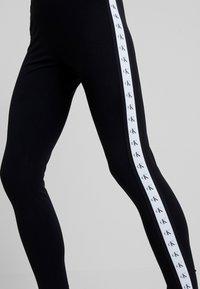 Calvin Klein Jeans - MONOGRAM TAPE MILANO - Leggings - Trousers - ck black/ bright white - 4