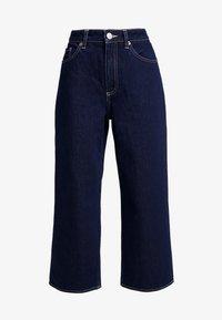 MOZIK RINSE - Flared Jeans - dark blue rinse wash