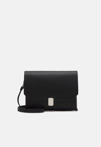 CROSS BODY BAG BUCKLE - Across body bag - black