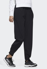 adidas Performance - STRETCHABLE WOVEN JOGGERS - Tracksuit bottoms - black - 3