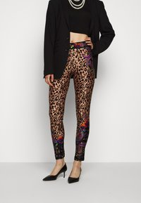 Versace Jeans Couture - Leggings - Trousers - nero - 0