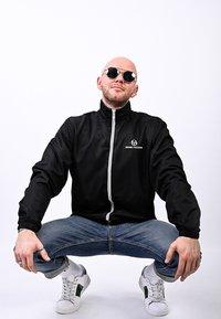 sergio tacchini - CARSON  - Training jacket - black/white - 2