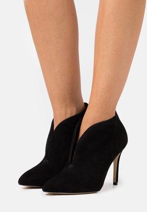 SLIP-ON - High heeled ankle boots - black
