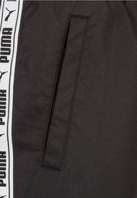 Puma - Tracksuit bottoms - black - 2