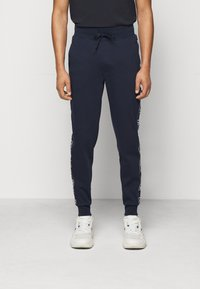 HUGO - DASCHKENT - Spodnie treningowe - dark blue - 0