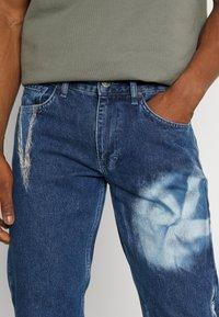 Jaded London - SPIRAL TIE DYE BOOTCUT - Straight leg jeans - blue - 4