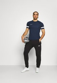 Nike Performance - ACADEMY 21 - Print T-shirt - obsidian/white - 1