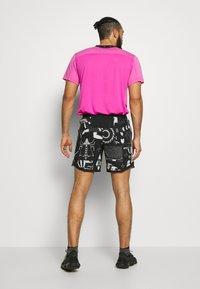 Nike Performance - WILD RUN - Sports shorts - black - 2
