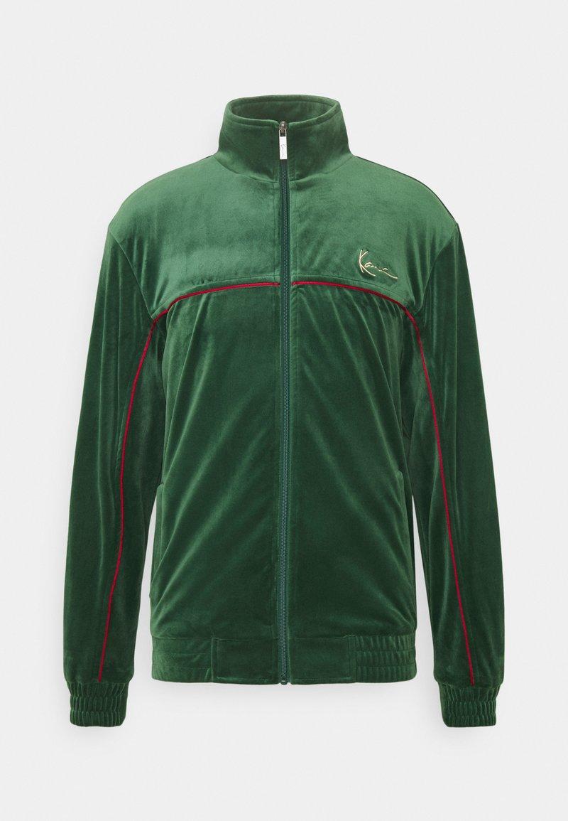 Karl Kani - SMALL SIGNATURE TRACK JACKET UNISEX - Training jacket - darkgreen