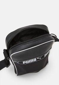 Puma - CAMPUS PORTABLE - Taška spříčným popruhem - black - 2