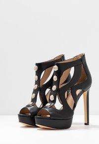 Guess - CABELLS - Platform heels - black - 4