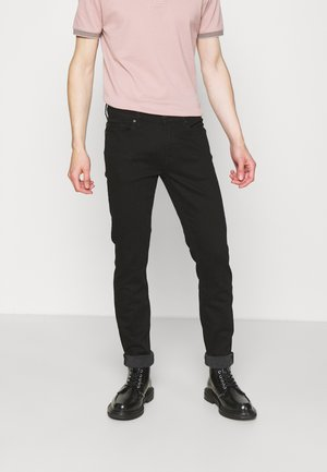 RONNIE LUXE PERFORMANCE - Straight leg jeans - rinse black