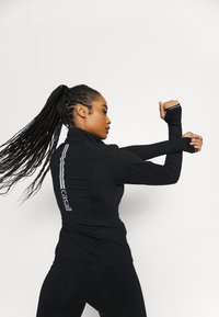 Casall - WINDTHERM JACKET - Sports jacket - black - 2