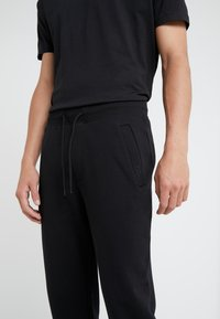 HUGO - DOAK - Tracksuit bottoms - black - 4