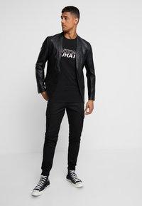 Antony Morato - PANT ON BOTTOM LEGS - Cargo trousers - black - 1