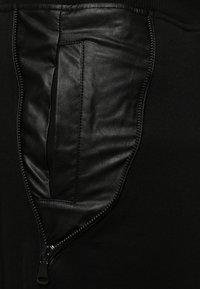 Urban Classics - Tracksuit bottoms - black/black - 4
