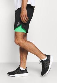 adidas Performance - SHORT - Pantalón corto de deporte - black/semi screaming green - 3