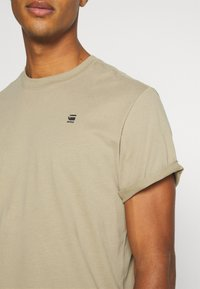 G-Star - LASH ROUND SHORT SLEEVE - T-shirt basic - light rock - 5