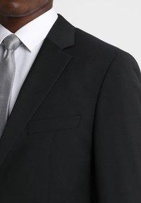 Tommy Hilfiger Tailored - SLIM FIT SUIT - Oblek - black - 6