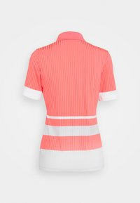 J.LINDEBERG - JUNE GOLF - Polo shirt - tropical coral - 1