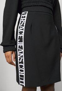Versace Jeans Couture - SKIRT LOGO TAPE - Pencil skirt - black - 5