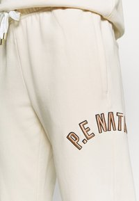P.E Nation - DROP SHOT TRACK PANT - Tracksuit bottoms - pearled ivory - 5