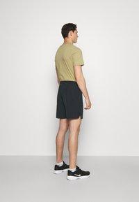 Nike Performance - SHORT - Pantalón corto de deporte - black/white - 2