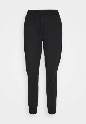 TRACKPANTS - Tracksuit bottoms - jet black