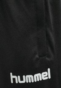 Hummel - Tracksuit bottoms - black