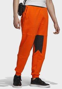 adidas Originals - ADVENTURE FIELD JOGGERS - Tracksuit bottoms - orange - 3