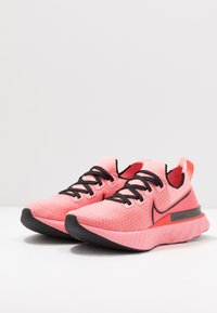 Nike Performance - EPIC PRO REACT FLYKNIT - Neutral running shoes - bright melon/black/ember glow - 2