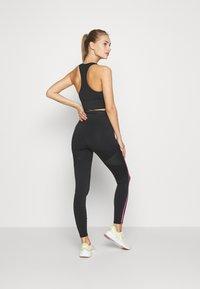 Puma - TRAIN BONDED ZIP HIGH RISE FULL - Leggings - black/pink/yellow - 2