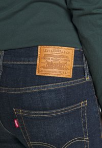 Levi's® - SKINNY TAPER - Jeans Skinny Fit - brimstone - 4