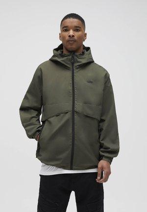 MIT KAPUZE - Vodotěsná bunda - khaki