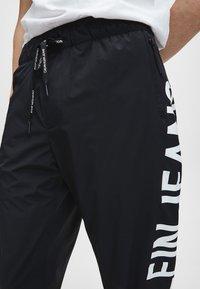 Calvin Klein Jeans - Pantaloni sportivi - ck black - 3