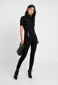 Guess - FERAH - Leggings - Trousers - jet black - 1