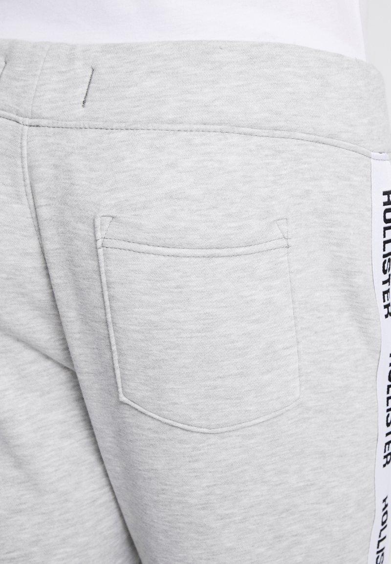 Hollister Co Tape Pantalon De Survetement Grey Noir Zalando Ch