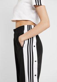 adidas Originals - ADIBREAK PANT - Tracksuit bottoms - black - 4
