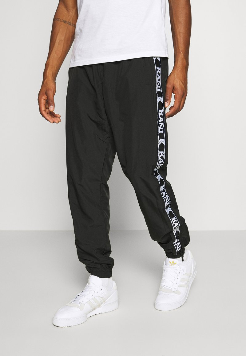 Karl Kani - TAPE TRACKPANTS - Trainingsbroek - black