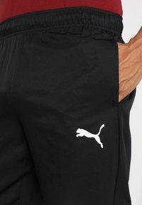 Puma - ACTIVE PANTS  - Pantalon de survêtement - puma black - 4