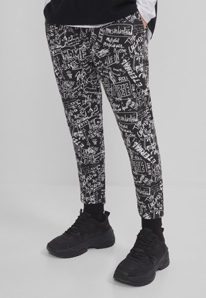 MIT GRAFFITI-PRINT - Tracksuit bottoms - black