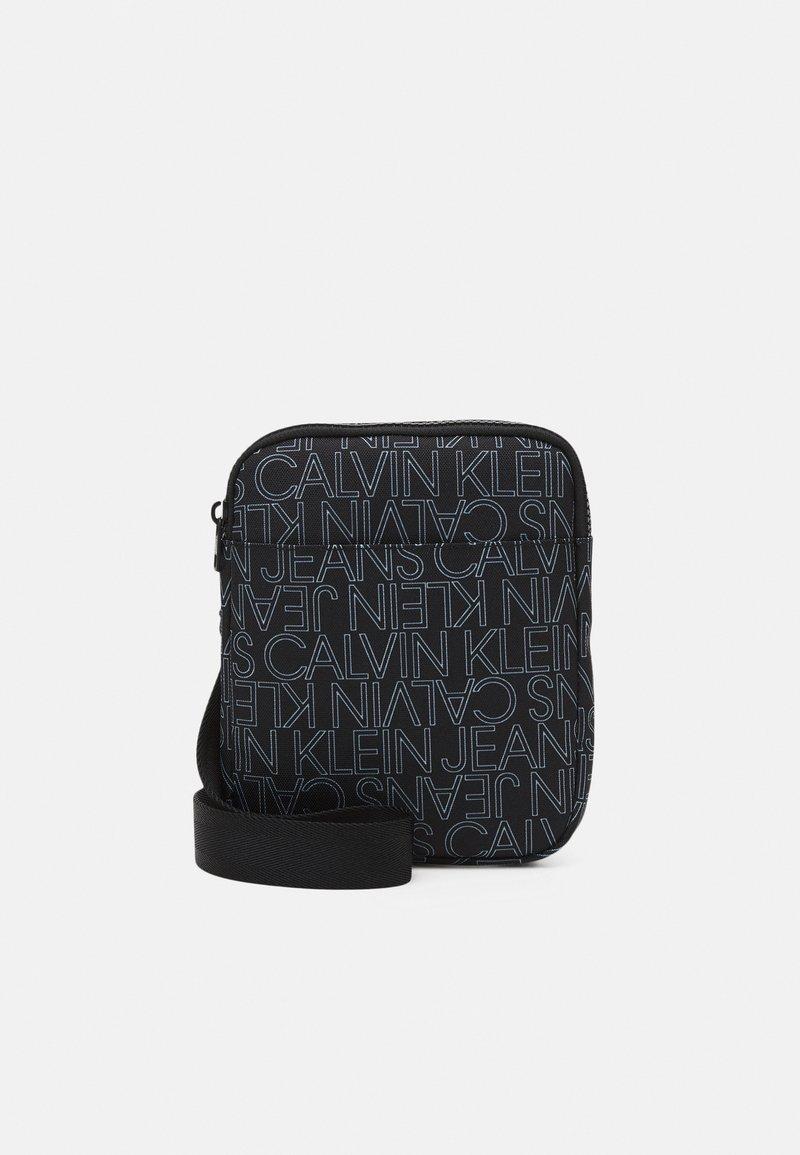 Calvin Klein Jeans - LOGO FLAT CROSS BODY BAG - Across body bag - black