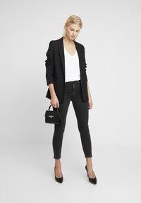 Calvin Klein Jeans - HIGH RISE - Skinny džíny - ca043 black - 1