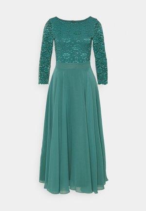 Společenské šaty - hydro
