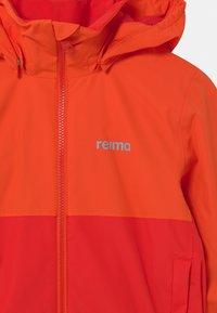 Reima - NIVALA UNISEX - Outdoor jacket - tomato red - 3