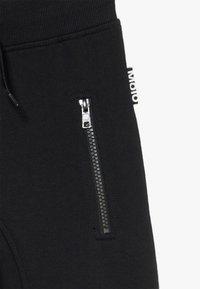 Molo - ASHLEY - Tracksuit bottoms - black - 4