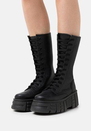 TRANSFORM - Lace-up boots - black