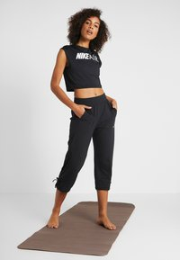 Nike Performance - YOGA PANT CROP - 3/4 sports trousers - black/white - 1