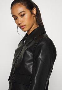Weekday - TAXI JACKET - Faux leather jacket - black - 4