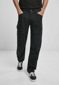 Brandit - ACCESSOIRES ADVEN  - Cargo trousers - black - 0